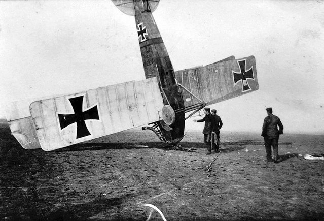 German soldiers attend to an upended German aircraft. (Photo by CC BY SA Carola Eugster via The Atlantic)