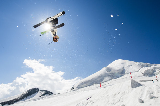 A free skier excercises on a kicker at the Freestyle Park on the Feegletscher glacier in Saas-Fee, Switzerland, Wednesday, July 22, 2015, while parts of the country experience a weeklong heat wave. (Photo by Dominic Steinmann/Keystone via AP Photo)