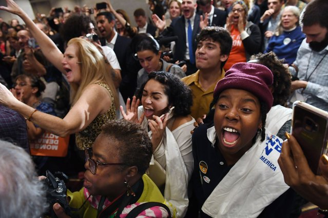 People celebrate during a Democratic election night watch party at the Hilton hotel in downtown Richmond, Va. on November 5, 2019. (Photo by Matt McClain/The Washington Post)