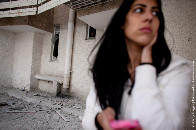 An Israeli woman reacts following a rocket attack from the nearby Gaza Strip