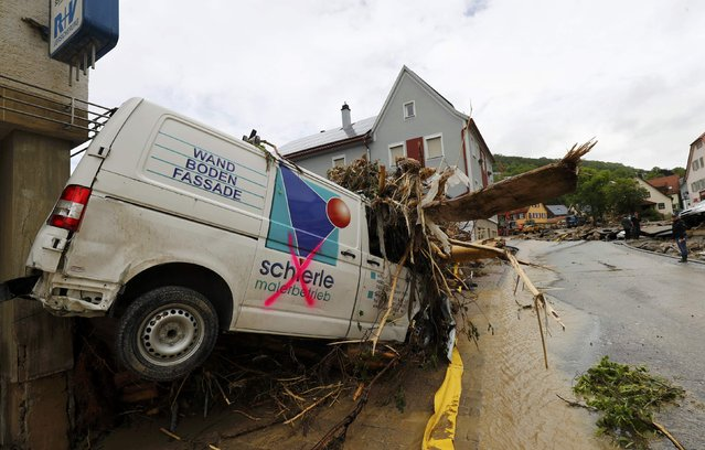 A damaged car and debris are pictured after floods in the town of Braunsbach, Germany, May 30, 2016. (Photo by Kai Pfaffenbach/Reuters)