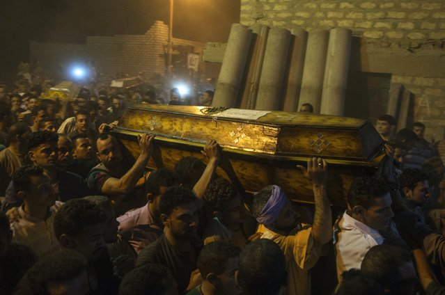 Mourners during the funeral of victims killed in an attack at the Monastery of St Samuel the Confessor, in Minya Province, central Egypt, 26 May 2017. According to news reports, a group of Coptic Christians were attacked in their bus en route to the Monastery when gunmen opened fire on them, killing at least 20 and injuring dozens. (Photo by Mohamed Hossam/EPA)