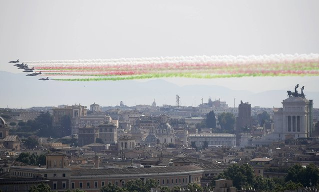 The Frecce Tricolori Italian Air Force acrobatic squad flies over Rome's skyline, including the Monument of the Unknown Soldier, at right, on the occasion of the 71st anniversary of founding of the Italian Republic in 1946, Friday, June 2, 2017. (Photo by Alessandra Tarantino/AP Photo)