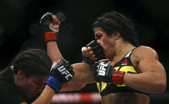Claudia Gadelha (R) of Brazil fights with Jessica Aguilar of Mexico during their Ultimate Fighting Championship (UFC) match, a professional mixed martial arts (MMA) competition in Rio de Janeiro, Brazil August 1, 2015. (Photo by Ricardo Moraes/Reuters)