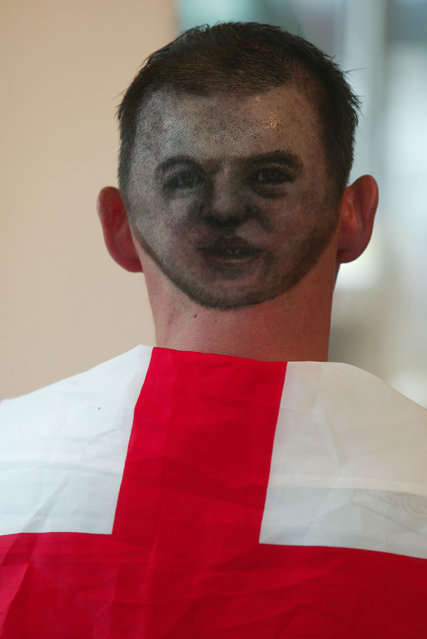 Shane Sutton (28), from Bognor Regis, West Sussex , has had an image of football star Wayne Rooney shaved onto the back of his head by hair stylist Daren Terry. (Photo by Southern News & Pictures)