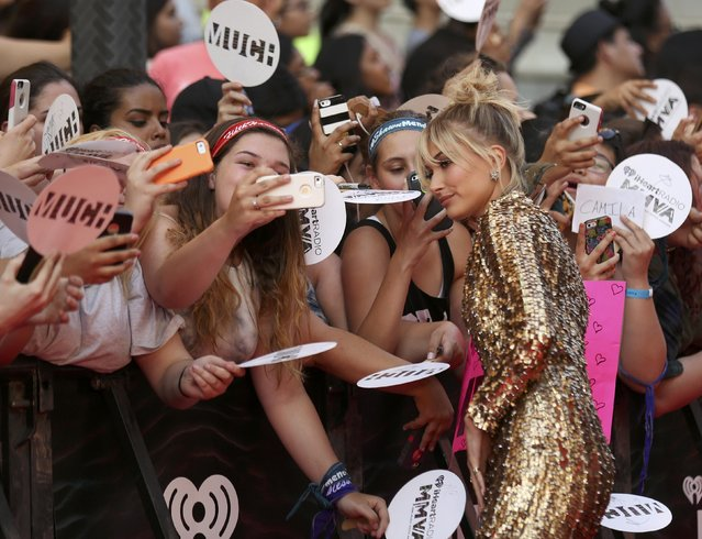 Model Hailey Baldwin poses for photos as she arrives at the iHeartRadio Much Music Video Awards (MMVAs) in Toronto, Ontario, Canada June 19, 2016. (Photo by Peter Power/Reuters)