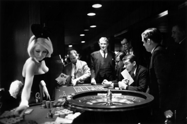 A Bunny Girl croupier spins the roulette wheel in the casino at London's Playboy Club, 20th December 1967. (Photo by David Cairns/Express/Hulton Archive/Getty Images)