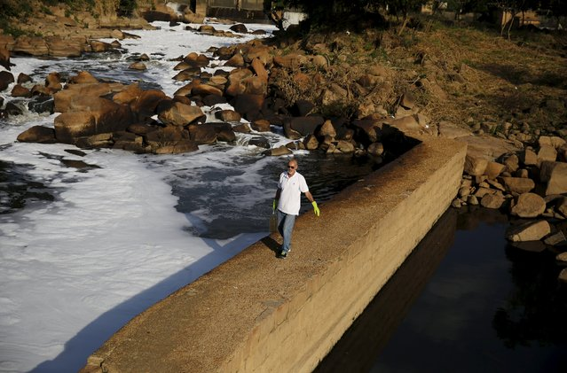 Ricardo Azevedo walks with water from the polluted Tiete River before filling the tank of his Honda NX 200 motorbike with it in Salto, northwest of Sao Paulo, Brazil, August 6, 2015. The Sao Paulo civil servant built the motorbike, which can cover up to 500 kilometres (311 miles) fuelled by just one litre of water.