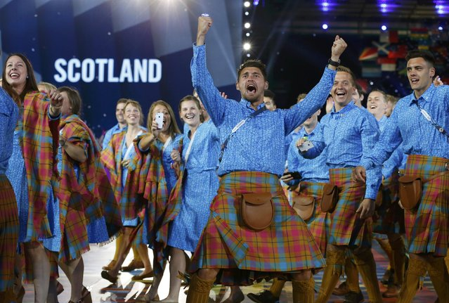 Scotland's Kenny Bain cheers as he and his teammates enter the stadium during the opening ceremony for the 2014 Commonwealth Games at Celtic Park in Glasgow, Scotland, July 23, 2014. (Photo by Phil Noble/Reuters)