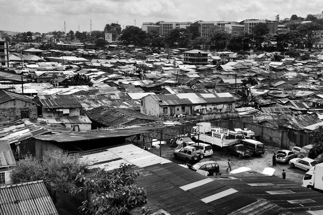 August 1, 2013 – Kampala, Uganda. Katanga in Kampala is a slum community where more than 20,000 people live under conditions of extreme poverty and without basic infrastructure such as permanent fresh water supply and brick houses. (Photo by Peter Bauza/ZUMA Press/VISUAL Press)