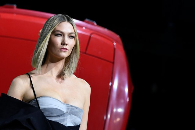 Model Karlie Kloss presents a creation by designer Virgil Abloh as part of his Fall/Winter 2020/21 women's ready-to-wear collection show for his label Off-White during Paris Fashion Week in Paris, France, February 27, 2020. (Photo by Piroschka van de Wouw/Reuters)