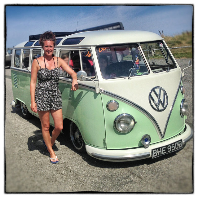 Sue Bunclark, 40, from Rotherham poses for a photograph besides her 1964 first generation or T1, split-screen Volkswagen Transporter Samba van in Newquay on August 6, 2014 in Cornwall, England. The van, which she and her family have owned for five years is nicknamed Sammy. (Photo by Matt Cardy/Getty Images)