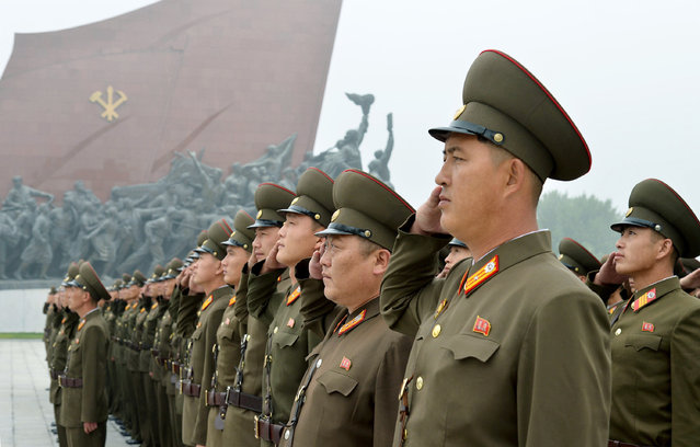 North Korean soldiers salute at Munsu Hill in Pyongyang, North Korea to mark the 69th anniversary of the country's founding Saturday, September 9, 2017. (Photo by Kyodo News via AP Photo)