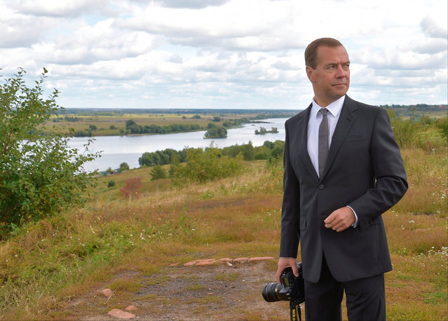 Russian Prime Minister Dmitry Medvedev visits the museum of the famous Russian poet Sergei Yesenin in the village of Konstantinovo, Ryazan region, 200 km (125 miles) southeast of Moscow, Russia, Tuesday, September 1, 2015. (Photo by Alexander Astafyev/RIA-Novosti, Government Pool Photo via AP Photo)