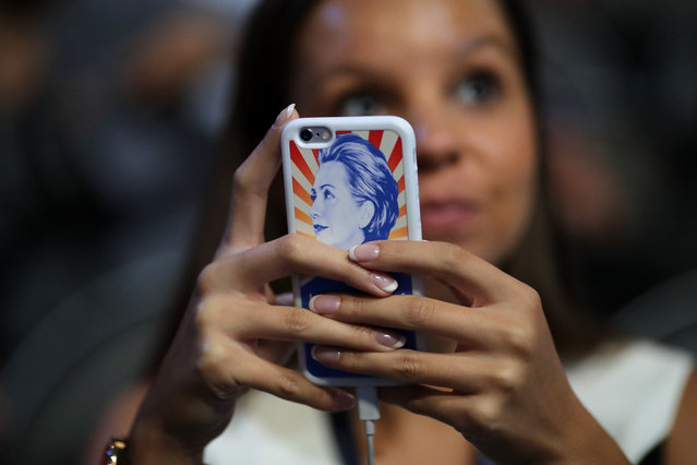 An attendee holds a phone with a Hillary Clinton themed case on the third day of the Democratic National Convention at the Wells Fargo Center, July 27, 2016 in Philadelphia, Pennsylvania. (Photo by Chip Somodevilla/Getty Images)