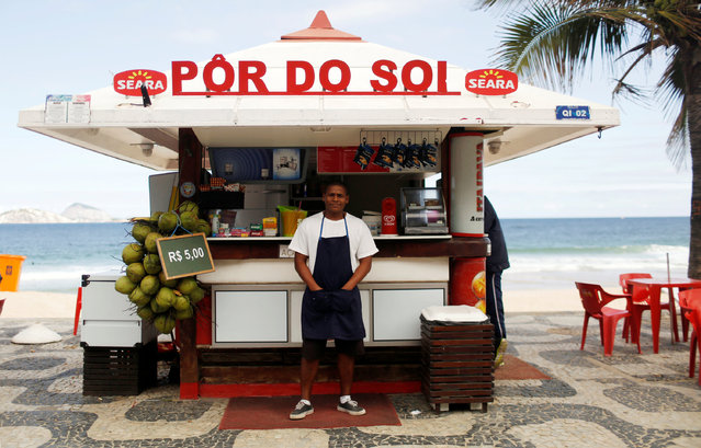 """Dayvison Nascimento, a 25-years-old bartender, poses for a portrait at the Ipanema beach in Rio de Janeiro, Brazil, June 24, 2016. Dayvison says, """"I expect many tourists will come here and enjoy the energy of the city and the event"""", but he is concerned that police could not control effectively the violence in the city. He hopes the impact of the Olympics will be positive and Rio de Janeiro will improve its international image. (Photo by Pilar Olivares/Reuters)"""