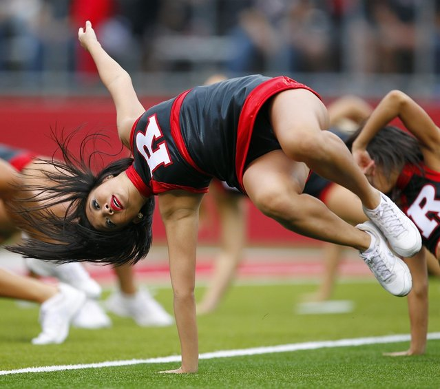 Rutgers Scarlet Knights cheerleaders perform during a game against the Connecticut Huskies at High Point Solutions Stadium on October 6, 2012 in Piscataway, New Jersey. Rutgers defeated Connecticut 19-3. (Photo by Rich Schultz)
