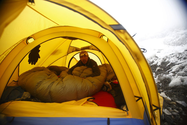 Phurba Tenzing Sherpa, 24, who has reached the summit of Everest nine times, sits inside his tent at Everest Base camp, approximately 17388 feet above sea level in Solukhumbu District May 6, 2014. (Photo by Navesh Chitrakar/Reuters)