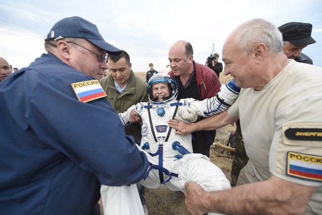Ground personnel carry Denmark's astronaut Andreas Mogensen after landing near the town of Dzhezkazgan (Zhezkazgan), Kazakhstan, in this September 12, 2015 handout picture. (Photo by Stephane Corvaja/Reuters/ESA)