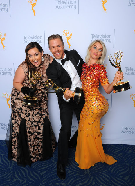 "Tessandra Chavez, from left, Derek Hough and Julianne Hough, winners of the award for outstanding choreography for ""Dancing With the Stars"", pose for a portrait at the Television Academy's Creative Arts Emmy Awards at Microsoft Theater on Saturday, September 12, 2015, in Los Angeles. (Photo by Vince Bucci/Invision for the Television Academy/AP Images)"