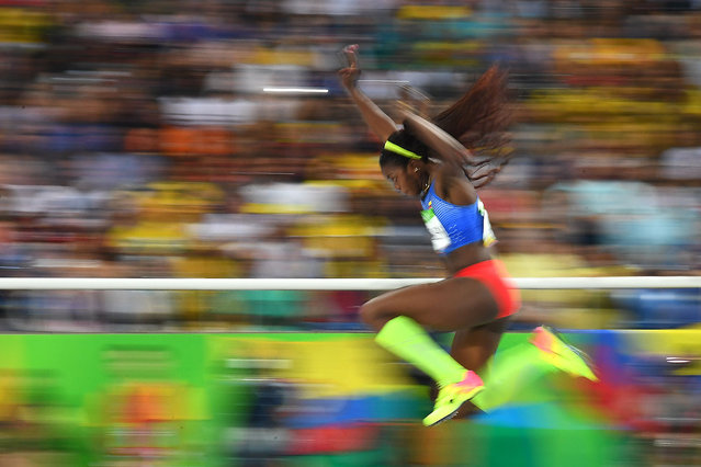 Colombia's Caterine Ibarguen competes in the Women's Triple Jump Final during the athletics event at the Rio 2016 Olympic Games at the Olympic Stadium in Rio de Janeiro on August 14, 2016. (Photo by Franck Fife/AFP Photo)