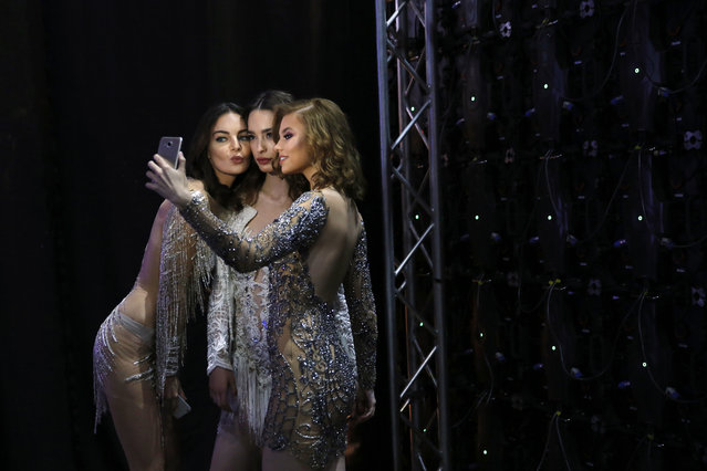 Models take a selfie backstage during the Beirut's Fashion Week in Beirut, Lebanon, Friday, November 3, 2017. (Photo by Hassan Ammar/AP Photo)
