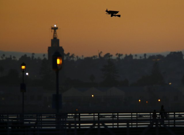 A radio-controlled flying witch travels across the ocean waters of Coronado, California October 7, 2014. (Photo by Mike Blake/Reuters)