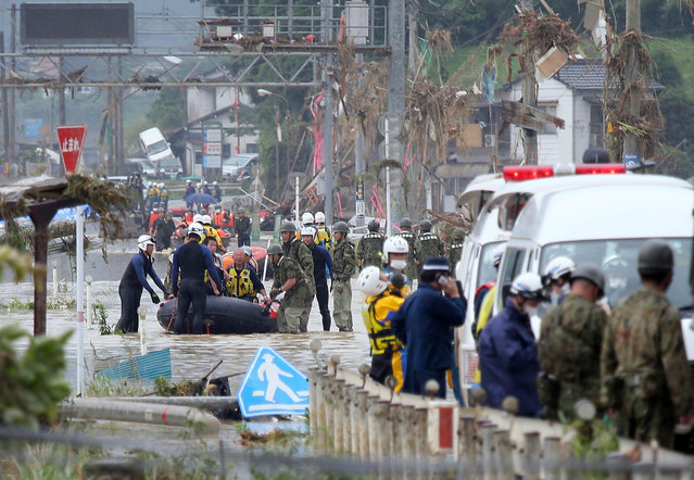 Rescue operationns continue in Kuma, Kumamoto prefecture, southwestern Japan, 05 July 2020. According to latest madia reports, more than 30 people are feared to have died and at least 14 are still missing due to the floods that hit Kumamoto prefecture on 04 July. (Photo by JIJI Press/EPA/EFE)