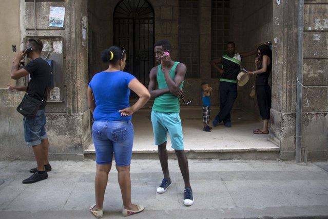 People use telephones in Havana, September 18, 2015. (Photo by Alexandre Meneghini/Reuters)