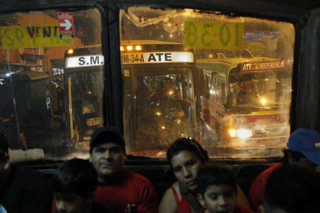 Passengers ride a public bus in a traffic jam in downtown Lima, April 4, 2014. (Photo by Enrique Castro-Mendivil/Reuters)