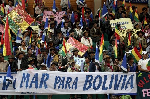 "Residents of Vila Vila attend at the inauguration of a sports arena called ""Coliseo Ban Ki-Moon"" in Vila Vila, south of Cochabamba, October 11, 2015. (Photo by David Mercado/Reuters)"