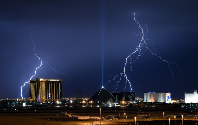 Lightning flashes west of (L-R) the Mandalay Bay Resort and Casino, the Luxor Hotel and Casino and the Excalibur Hotel & Casino on the Las Vegas Strip on July 2, 2016 in Las Vegas, Nevada. Two days of monsoon thunderstorms brought strong winds, hail and heavy rain to parts of the valley causing street flooding and power outages. (Photo by Ethan Miller/Getty Images)