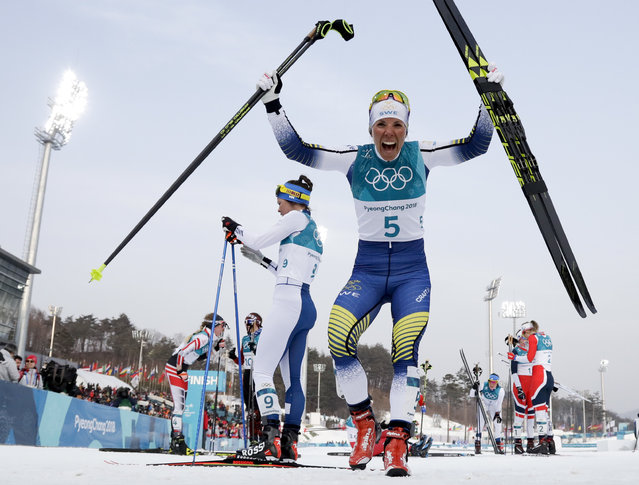Charlotte Kalla of Sweden, celebrates after winning the gold medal in the women's 7.5km /7.5km skiathlon cross-country skiing competition at the 2018 Winter Olympics in Pyeongchang, South Korea, Saturday, Feb. 10, 2018. (Photo by Matthias Schrader/AP Photo)