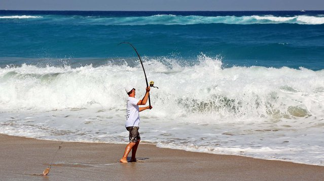 Josh Jorgensen, Founder and Director of the Blacktip Challenge Shark Fishing Tournament, casts for sharks on Midtown Beach. (Photo by Lannis Waters/Palm Beach Daily News)