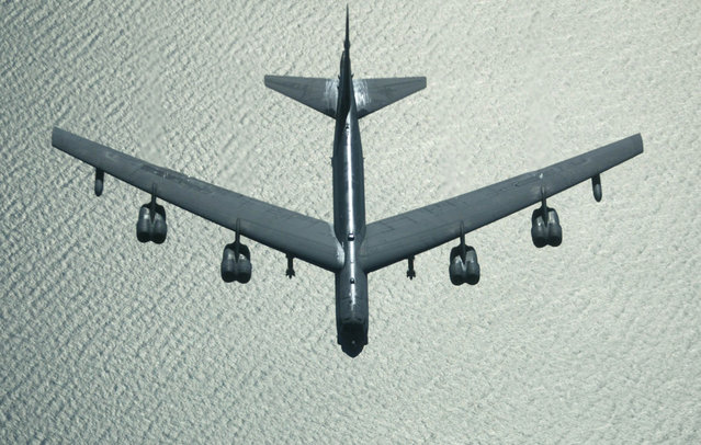 A U.S. Air Force B-52 bomber returns from a mission over Iraq, after refueling from a KC-10 plane over the Black Sea, on March 28, 2003. (Photo by Jockel Finck/AP Photo/The Atlantic)