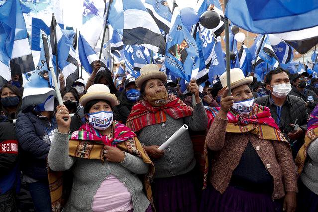 Supporters of Luis Arce, who is running for president with the Movement Towards Socialism Party (MAS), attend Arce's closing campaign rally in El Alto, Bolivia, Wednesday, October 14, 2020. Elections will be held Oct. 18. (Photo by Juan Karita/AP Photo)