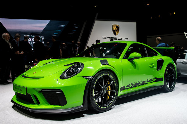 Porsche 911 GT3RS is displayed at the 88th Geneva International Motor Show on March 6, 2018 in Geneva, Switzerland. Global automakers are converging on the show as many seek to roll out viable, mass-production alternatives to the traditional combustion engine, especially in the form of electric cars. The Geneva auto show is also the premiere venue for luxury sports cars and imaginative prototypes. (Photo by Robert Hradil/Getty Images)