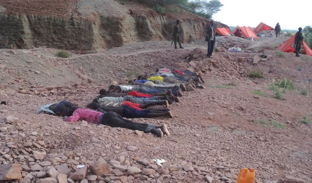 Bodies of Kenyans lie at a quarry in Mandera County, Kenya, Tuesday, December 2, 2014. Kenya police said that at least 36 quarry workers were killed in an attack in northern Kenya  by suspected Islamic extremists from Somalia. Kenyan police chief David Kimaiyo confirmed the workers were killed early Tuesday in Mandera County. (Photo by AP Photo)