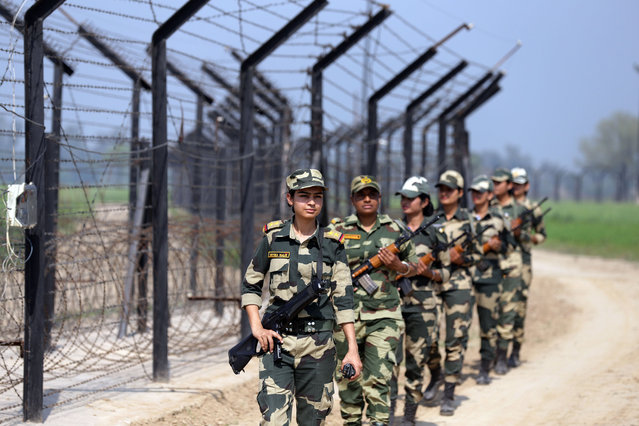 Female Indian Border Security Force's (BSF) soldiers patrol along the India-Pakistan border during International Women's Day near Border Outpost Pul Moran, some 37 km from Amritsar, India, 08 March 2018. International Women's Day is globally observed on 08 March, to highlight the struggles of women around the globe. March 08 was proclaimed by the United Nations General Assembly as the day for women's rights in 1977. (Photo by Raminder Pal Singh/EPA/EFE)