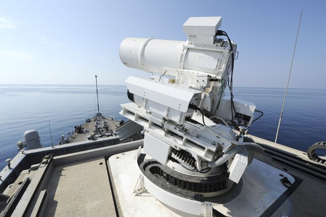 The laser weapon system (LaWS) is tested aboard the USS Ponce amphibious transport dock during  an operational demonstration while deployed in the Gulf in this November 15, 2014 U.S. Navy handout photo provided December 11, 2014.  The weapon system has performed beyond expectations in four months of operational testing, the chief of Navy research said on Wednesday, lifting hopes for a new U.S. defense against cheap anti-ship arms. (Photo by John Williams/Reuters/U.S. Navy)