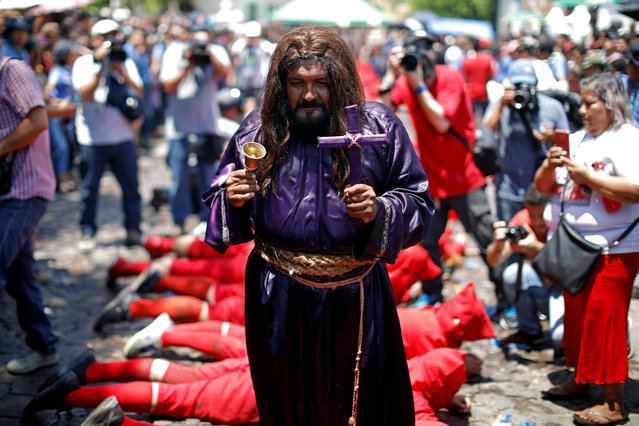 A man dressed as Jesus Christ participates in a ceremony known as Los Talciguines, as part of religious activities to mark the start of the Holy Week in Texistepeque, El Salvador, March 26, 2018. (Photo by Jose Cabezas/Reuters)