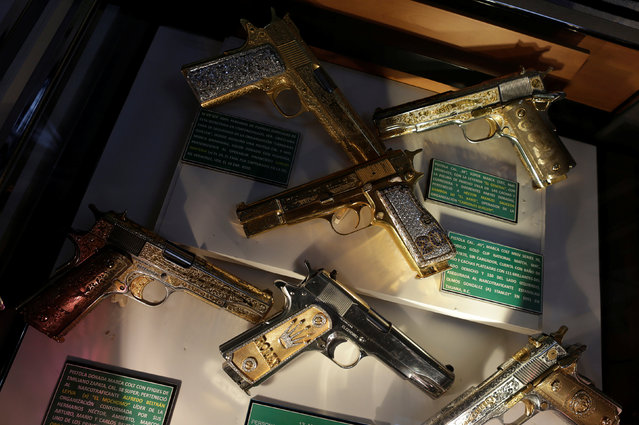 Guns decorated with gold and jewellery are displayed in the Drugs Museum, used by the military to showcase to soldiers the lifestyles of Mexican drug lords, at the headquarters of the Ministry of Defense in Mexico City, October 14, 2016. (Photo by Henry Romero/Reuters)