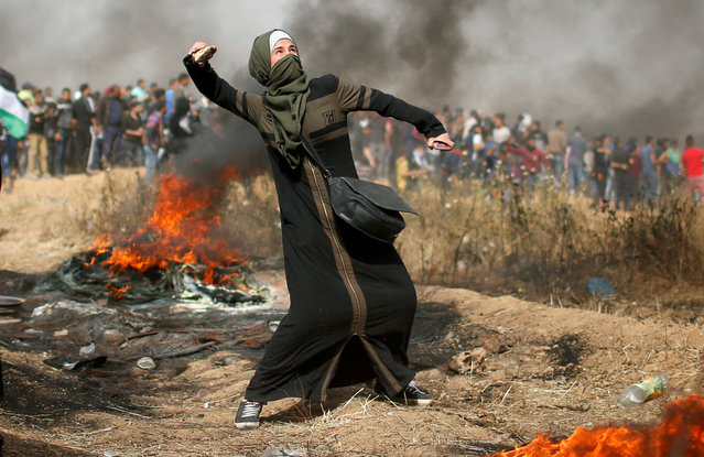 A girl hurls stones during clashes with Israeli troops at a protest where Palestinians demand the right to return to their homeland, at the Israel-Gaza border, east of Gaza City, April 13, 2018. (Photo by Mohammed Salem/Reuters)