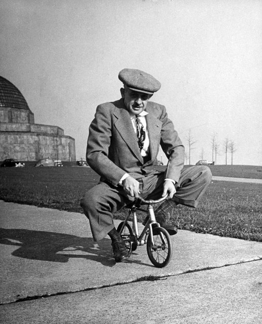 "Chicago bicycle dealer Andy Koslow rides a tiny bike built by a former vaudevillian, 1948. ""This helps limber up his left leg"", LIFE wrote, ""which, as a former motorcycle racer, he broke seven times"". (Photo by Wallace Kirkland/Time & Life Pictures)"