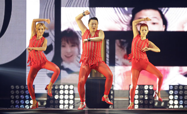 """South Korean singer PSY, center, performs during his concert """"All Night Stand"""" in Seoul, South Korea, Saturday, December 20, 2014. (Photo by Lee Jin-man/AP Photo)"""