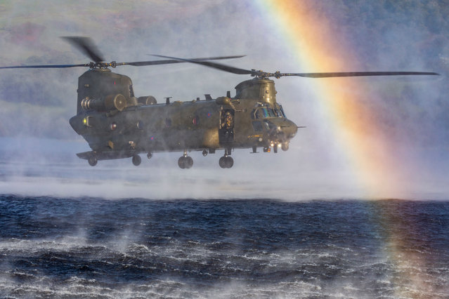 RAF Equipment, highly commended. An RAF Chinook performs a simulated water insertion over a lake. (Photo by Cpl Tim Laurence/2020 RAF Photo Competition)