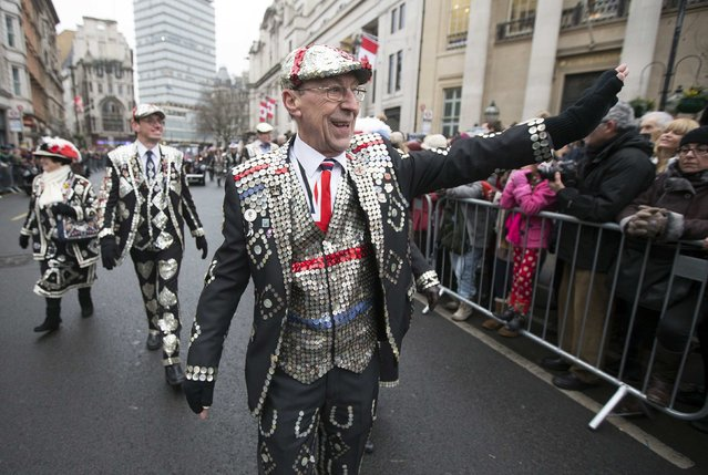 Members of the Pearly Kings and Queens parade during the annual New Year's Day parade in London January 1, 2015. (Photo by Peter Nicholls/Reuters)