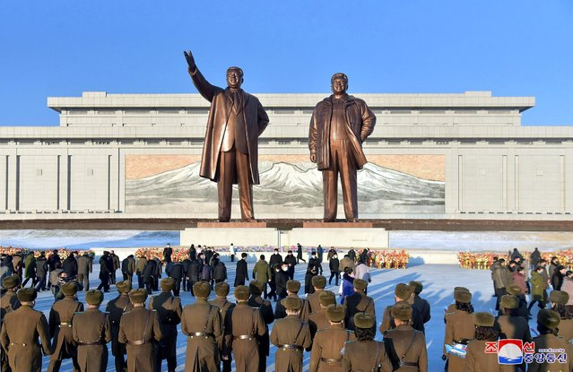 People offer flowers and visit the statues of President Kim Il Sung and Chairman Kim Jong Il to pay tribute to late leader Kim Jong Il in commemoration of the ninth anniversary of his death in Pyongyang, North Korea on December 17, 2020.  (Photo by KCNA via Reuters)