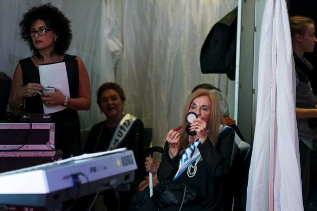 Rita Casimo Brown, 81, (C) a Holocaust survivor, has her make-up done during a beauty contest for survivors of the Nazi genocide in the northern Israeli city of Haifa, November 24, 2015. (Photo by Amir Cohen/Reuters)