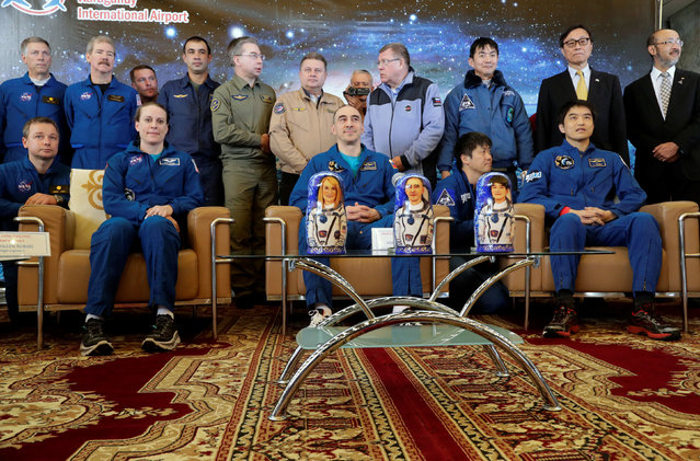 International Space Station (ISS) crew members Kate Rubins of the U.S., Anatoly Ivanishin of Russia and Takuya Onishi of Japan pose for a photo at the airport in Karaganda, Kazakhstan, October 30, 2016. (Photo by Dmitri Lovetsky/Reuters)